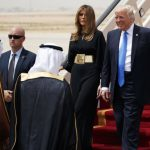 U.S. President Donald Trump, accompanied by first lady Melania Trump, smiles at Saudi King Salman, left, upon his arrival at a welcome ceremony at the Royal Terminal of King Khalid International Airport, Saturday, May 20, 2017, in Riyadh. Trump opened his first trip abroad since taking office, touching down Saturday in Saudi Arabia for a visit aimed at building stronger partnerships to combat terrorism in the region and moving past the controversies engulfing his young administration. (AP Photo/Evan Vucci)