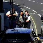 This is the terrifying moment a brazen thief arrested during a police chase after they knocked him off his Boris bike - by ramming him with their van door. See National News story NNRAMMED; Jake Nedd, 31, raided a black Range Rover parked outside a row of terraced houses before fleeing the scene laden with bags from the boot and front of the vehicle. The criminal, who had noticed the 4x4 with its passenger window, fled the scene on a hired bike and was weaving across the road from the weight of the valuables. Police, who had been called to the scene on Dawes Road, Fulham, west London, where houses sell for upwards of £1.2 million, began tearing down the street with their lights flashing.