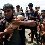 ATTENTION EDITORS - VISUAL COVERAGE OF SCENES OF INJURY OR DEATH Nasir Ahmed, a Rohingya refugee man cries as he holds his 40-day-old son, who died as a boat capsized in the shore of Shah Porir Dwip while crossing Bangladesh-Myanmar border, in Teknaf, Bangladesh, September 14, 2017. REUTERS/Mohammad Ponir Hossain